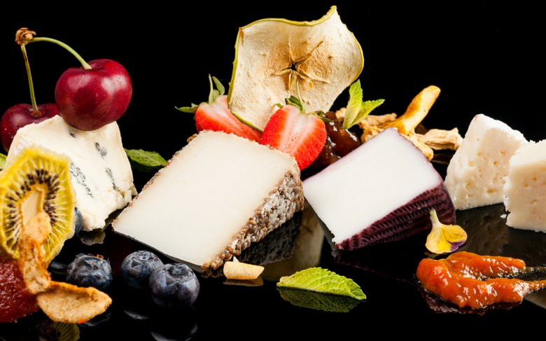Sorted Cheese Plate with Fruits in Texture